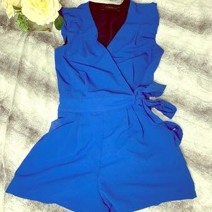 Royal Blue Ruffled Sleeve Romper with waist tie